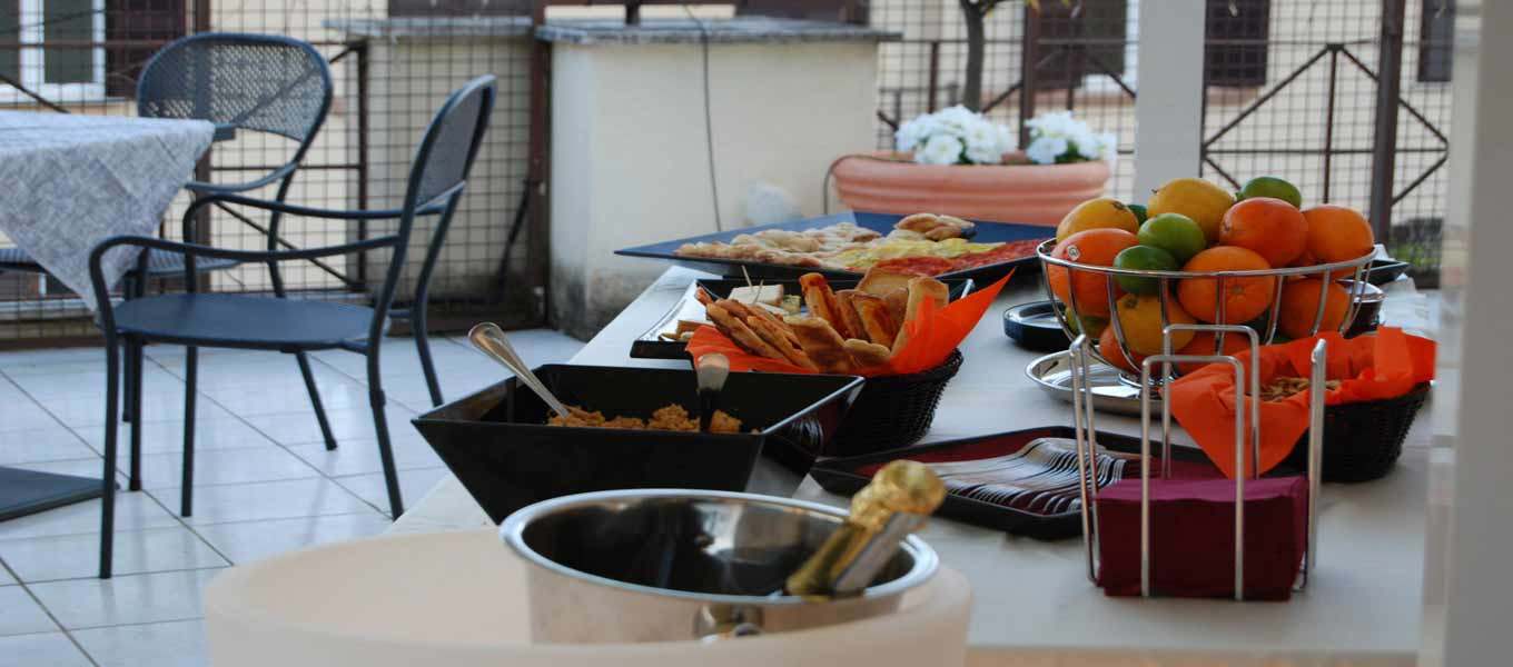 Breakfast in our roof garden at hotel residence Vatican Suites. Make direct reservation only with our official web site.